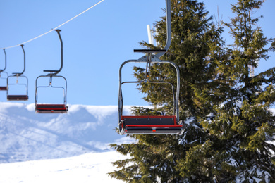 Empty chairlift at mountain ski resort. Winter vacation