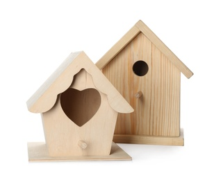 Two different bird houses on white background