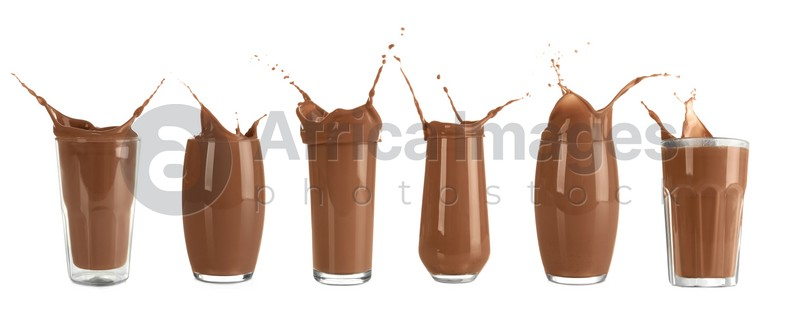 Set with delicious chocolate milk splashing out of glasses on white background. Banner design