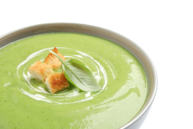 Tasty homemade zucchini cream soup isolated on white, closeup
