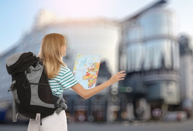 Traveler with map in foreign city. Summer vacation trip
