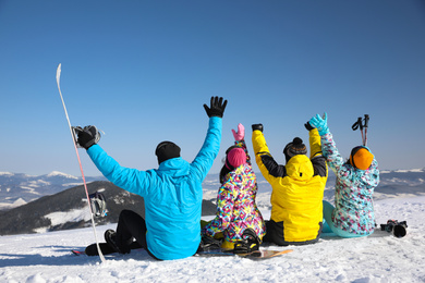 Group of friends with equipment at ski resort. Winter vacation