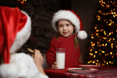 Cute little children at table in dining room. Christmas time
