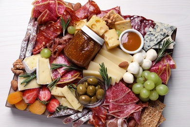 Assorted appetizers served on white wooden table, top view