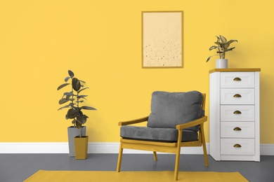 Color of the year 2021. Stylish armchair and plants in room