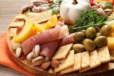 Different tasty appetizers on wooden table, closeup