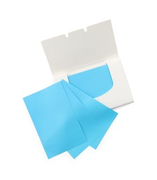 Open package of facial oil blotting tissues on white background, top view