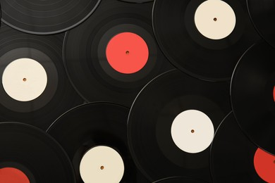 Vintage vinyl records as background, top view
