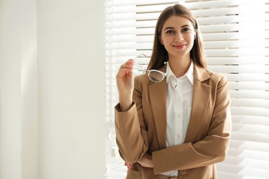 Portrait of beautiful young businesswoman in office