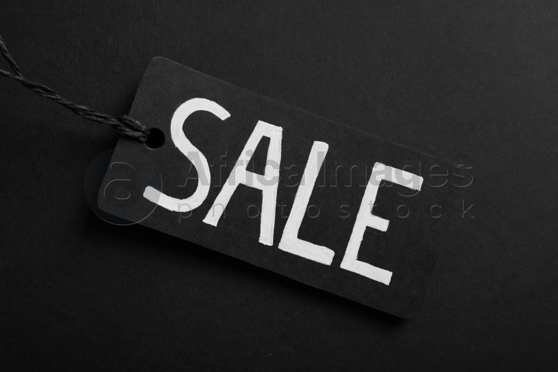 Sale Tag on color background, top view. Black Friday