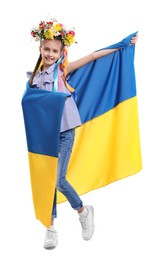 Girl in flower wreath with flag of Ukraine on white background