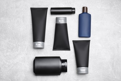 Flat lay composition with set of men's cosmetic products on light grey background
