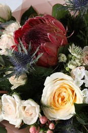 Beautiful bouquet with roses as background, closeup