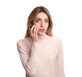Woman checking her health condition on white background. Yellow eyes as symptom of problems with liver