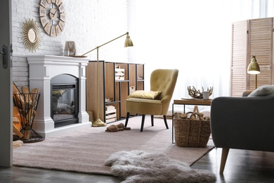 Firewood and modern furniture in light living room