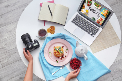 Food blogger preparing breakfast at table table, top view
