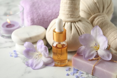 Spa composition with skin care products on white table, closeup