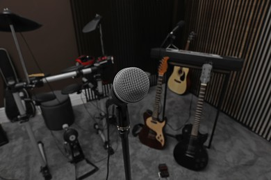 Modern microphone at recording studio. Music band practice