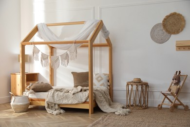 Stylish child room interior with house bed