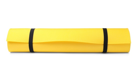 Yellow rolled mat isolated on white. Camping tourism equipment