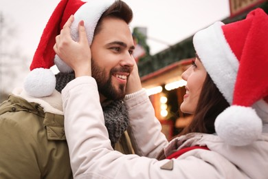 Lovely couple spending time together at Christmas fair