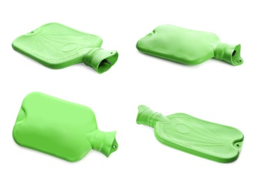 Set with green rubber hot water bottles on white background