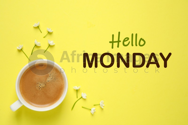 Hello Monday, start your week with good mood. Cup of freshly brewed aromatic coffee and flowers on yellow background, flat lay