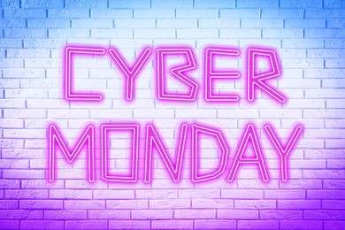 Neon sign Cyber Monday on white brick wall
