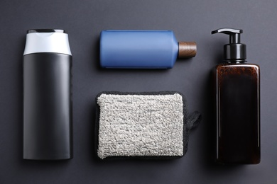 Flat lay composition with men's cosmetic products on black background
