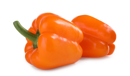 Ripe orange bell peppers isolated on white