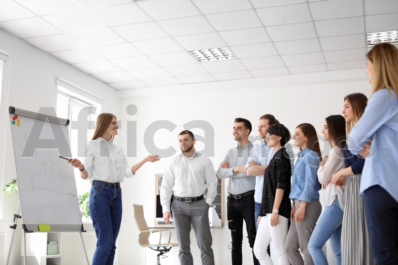 Female business trainer giving lecture in office