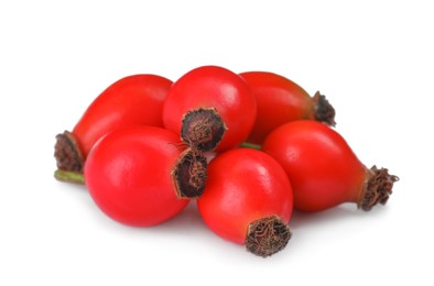 Heap of ripe rose hip berries on white background
