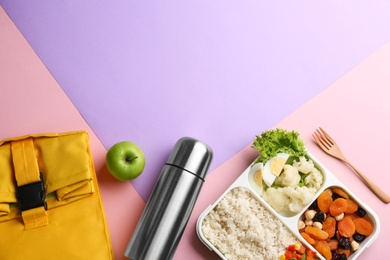 Flat lay composition with thermos and food on color background. Space for text