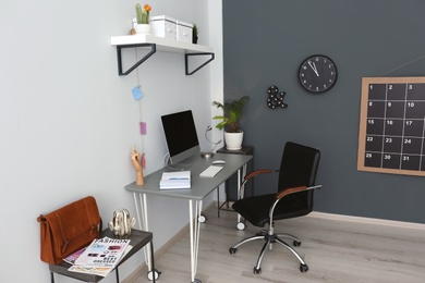 Comfortable workplace with computer on desk in home office