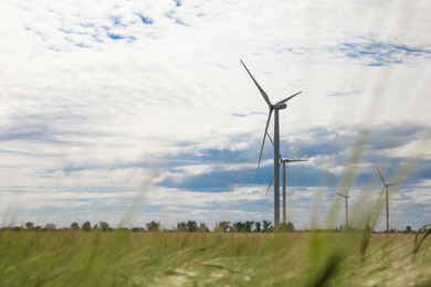 Beautiful view of field with wind turbines. Alternative energy source