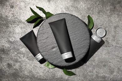 Set of men's cosmetic products on grey table, flat lay