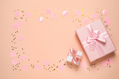 Frame of shiny confetti and beautiful gift boxes on color background, flat lay. Space for text