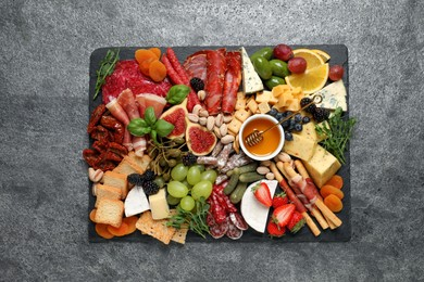 Set of different delicious appetizers served on grey table, top view