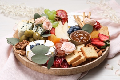 Assorted appetizer served on white wooden background