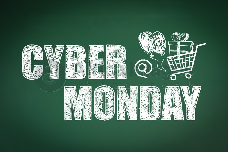 Text Cyber Monday Sale and picture of small shopping cart on green chalkboard