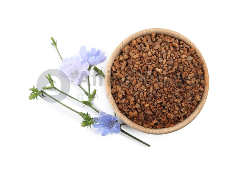 Bowl of chicory granules and flowers on white background, top view