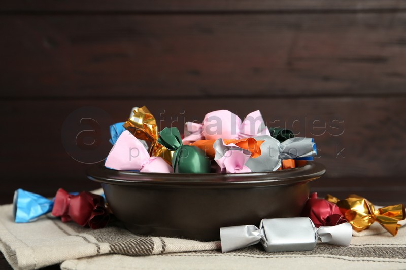 Candies in colorful wrappers on table, closeup
