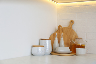 Wooden boards and different kitchen items on countertop indoors