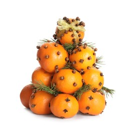 Pomander balls made of tangerines with cloves and fir branches on white background
