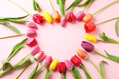 Heart made of beautiful tulip flowers on color background, flat lay. Space for text