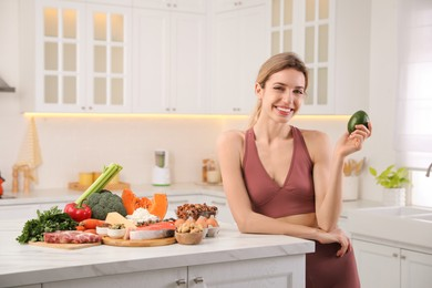 Woman with healthy food in kitchen. Keto diet
