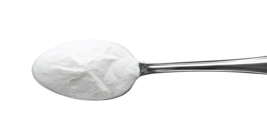 Spoon of baking soda isolated on white, top view