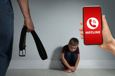 Woman calling domestic violence hotline to prevent aggression upon little boy