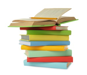 Many colorful hardcover books with pencil on white background