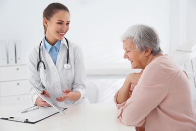 Senior woman visiting doctor in modern office